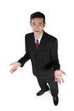 Always questioning. High angle full shot of young Asian businessman looking at camera with quizzical expression, isolated on white background Stock Images
