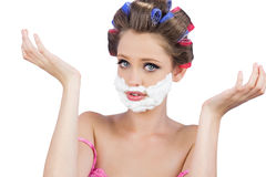 Questioning woman with shaving foam on face Stock Photos