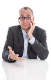 Questioningly bald engineer or specialist sitting at desk isolat Stock Photo