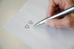 Questionnaire. White questionnaire and hand with pen Royalty Free Stock Photo