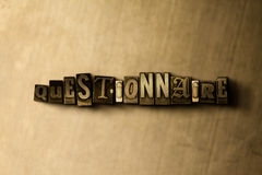 QUESTIONNAIRE - close-up of grungy vintage typeset word on metal backdrop Stock Photo
