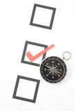Questionnaire and compass Stock Images