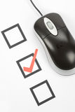 Questionnaire and computer mouse Royalty Free Stock Image