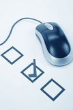 Questionnaire and computer mouse Stock Images