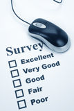 Questionnaire and computer mouse Royalty Free Stock Images