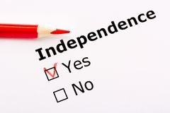 Questionnaire concept. Independence heading with Yes and no checkboxes and red pencil. Questionnaire concept. Independence heading with Yes and no checkboxes Royalty Free Stock Photography