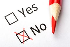 Questionnaire concept. Yes or No checkboxes with red pencil. Close up image.  Royalty Free Stock Photography