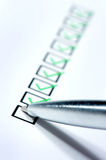 Questionnaire. With green ticks and metal pen Stock Photography