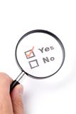 Questionnaire and magnifier Stock Photography