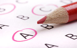 Questionnaire with pencil. A multiple choice questionnaire with red pencil Stock Photos