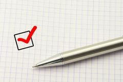 Questionnaire template, survey choice. Education test. Answer concept. Marked checkbox with a pen on paper background. Questionnaire template, survey choice stock photo