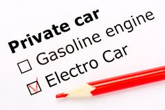 Questionnaire. White paper sheet with checkboxes and red pencil. Survey asks the persons about private car engine: gasoline or ele Royalty Free Stock Images
