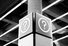 Questions. An image of two large question mark signs inside of a building Royalty Free Stock Image