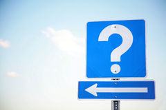 Questions? Answers?. Blue sign with a white question mark above a direction arrow with a blue sky background Royalty Free Stock Image