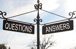 Questions Answers. A sign shows the path of questions and the path of answers Royalty Free Stock Photo