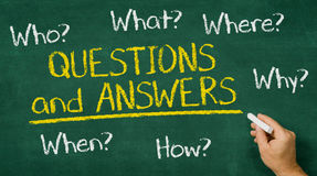 Questions and Answers. Hand writing on a chalkboard - Questions and Answers Stock Image