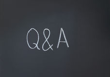 Questions and Answers. Inscription in chalk on a blackboard Royalty Free Stock Photos
