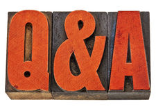 Questions and answers - Q&A. Q&A - questions and answers acronym - isolated text in vintage letterpress wood type stained by red ink Royalty Free Stock Photos