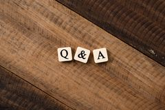 Questions and Answers Q&A concept. Questions and Answers Q&A concept. Q&A letter on alphabet tiles on wooden table Royalty Free Stock Photos