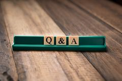 Questions and Answers Q&A concept. Questions and Answers Q&A concept. Q&A letter on alphabet tiles on wooden table Royalty Free Stock Photography