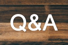Questions and answers Q&A concept. Questions and answers Q&A concept. Q&A word with blurred wooden background Royalty Free Stock Photos