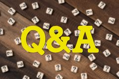 Questions and Answers Q&A concept. Q&A word with question mark tiles as blurred background stock photos