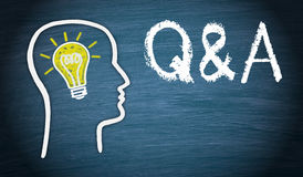 Questions and answers. Q & A - Questions and Answers illustration. A head with a light bulb on blue chalkboard background