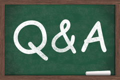 Questions and Answers. Q&A written on a chalkboard with a piece of white chalk Royalty Free Stock Image