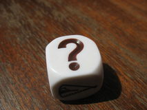 Questions and answers. Scattered cubes with symbols for the game around the table Royalty Free Stock Image