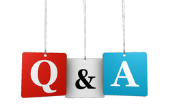 Questions And Answers. Web and Internet concept with q and a letters and sign on hanged tags isolated on white background Stock Photos
