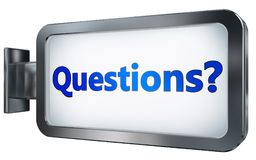 Questions? on billboard background. Questions? wall light box billboard background , isolated on white Stock Photo