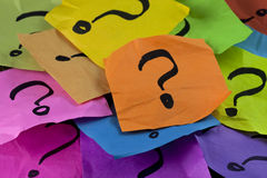 Questions or decision making concept. Questions, decision making or uncertainty concept - a pile of colorful crumpled sticky notes with question marks Stock Photo