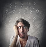 Questions and doubts. A man has got many questions and doubts Royalty Free Stock Photos