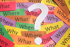 Questions and mark background. Lots of question notes and white question mark royalty free stock photo