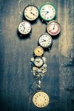 Questions mark made of old clocks and spare parts. On wooden table royalty free stock images