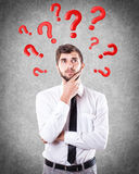 Questions round a head. Red questions round a head of the beautiful boy Royalty Free Stock Photos