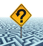 Questions Searching For Solutions. As a yellow traffic sign with an arrow shaped in a question mark on a confusing complex dimensional maze and labyrinth fading Stock Images
