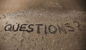 QUESTIONS text in large letters with sepia toned effect royalty free stock photo