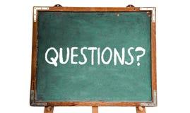 Questions ? textotez le message de mot dans la craie blanche écrite sur un tableau en bois ou un tableau noir de vieux vintage sa Photos stock