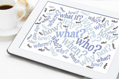 Questions word cloud on a digital tablet. Who, what, when, where, why, how questions - brainstorming concept - word cloud on a tablet with a cup of espresso stock photos
