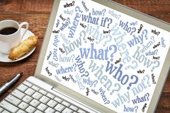 Questions word cloud on laptop. Who, what, when, where, why, how questions - brainstorming concept - word cloud on a laptop screen with a cup of coffee stock illustration