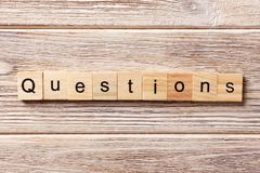 Questions word written on wood block. Questions text on table, concept stock image