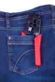 Quetschwerkzeug in einer Tasche Jeans Lizenzfreies Stockfoto