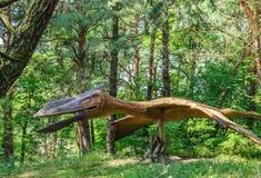 Quetzalcoatlus dinosaur statue. Life sized Raptor Quetzalcoatlus dinosaur statue in a forest Stock Photos