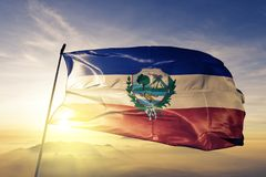 Quetzaltenango Department of Guatemala flag textile cloth fabric waving on the top sunrise mist fog. Beautiful royalty free stock photography