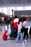Queue airport. Long queue of people at modern international airport stock images
