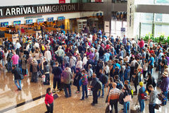 Queue at airport immigration. SINGAPORE - JAN 13, 2017: People waiting in queue at arrival immigration of Changi airport. Changi International Airport serves stock images