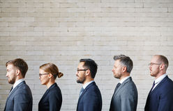 Queue of business people. Several employees standing in queue along wall Stock Images