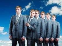 Queue of businessmans isolated on sky view Royalty Free Stock Photos