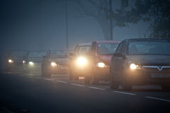 Queue of cars in fog Stock Photography